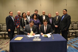 USET Tribal leadership looks on as USET President Brian Patterson and SBA Office of Native American Affairs Assistant Administrator Chris James signs the Strategic Alliance Memorandum.