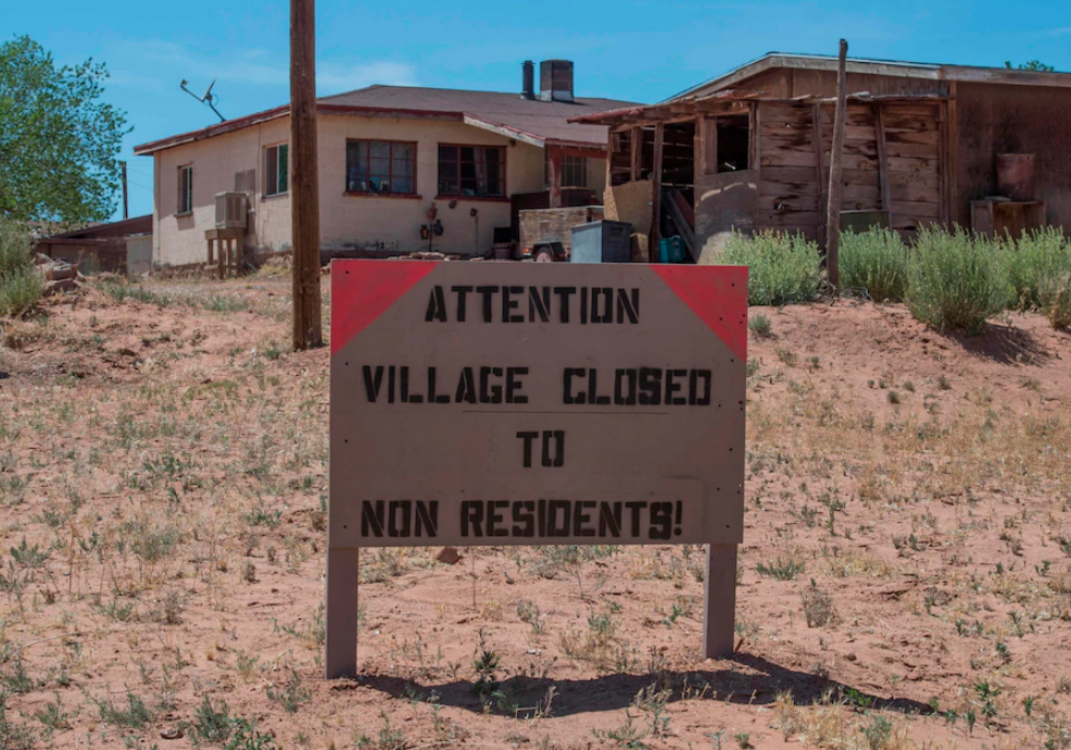 A sign warns nonresidents to stay out of the Navajo Nation town of Tuba City in Arizona in an attempt to stop the spread of covid-19. (Mark Ralston/AFP via Getty Images)