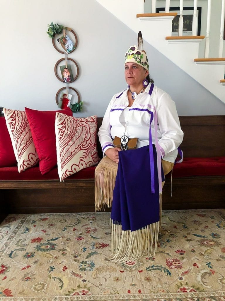 """Jessie """"Little Doe"""" Baird, a citizen of the Mashpee tribe, wears Wampanoag regalia. Baird is a linguist best known for her work to reclaim and teach the Wampanoag language through the Wôpanâak Language Reclamation Project."""